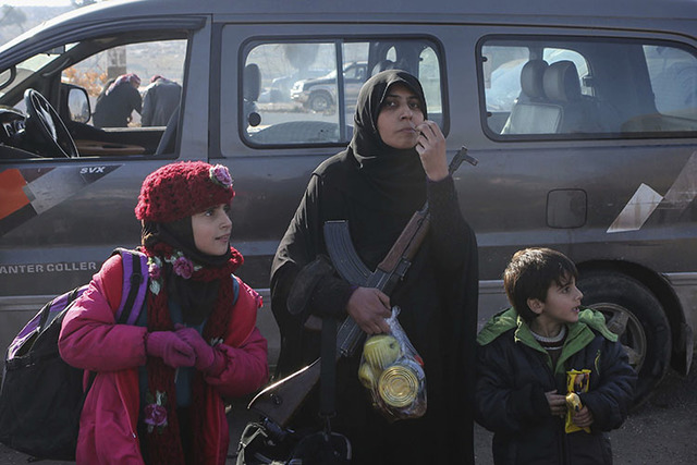 Syrians evacuated from the embattled Syrian city of Aleppo during the ceasefire arrive at a refugee camp in Rashidin, near Idlib, Syria, Tuesday, Dec. 20, 2016.  (AP Photo)