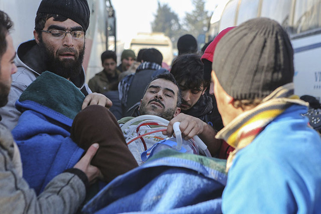 An injured Syrian arrives at a refugee camp in Rashidin, near Idlib, Syria, after was evacuated from the embattled Syrian city of Aleppo during the ceasefire, Tuesday, Dec. 20, 2016.  (AP Photo)