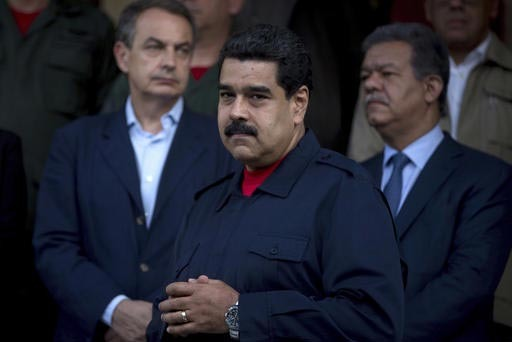 The president of Venezuela, Nicolas Maduro, appears in this July 21, 2016, photo with the former prime minister of Spain,  Jose Luis Rodriguez Zapatero, right, and former president of the Dominica ...