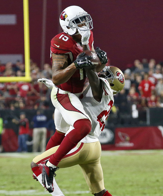 Arizona Cardinals wide receiver Michael Floyd (15) can't hold on to the football as San Francisco 49ers cornerback Tramaine Brock (26) defends during the second half of an NFL football game, Sunda ...
