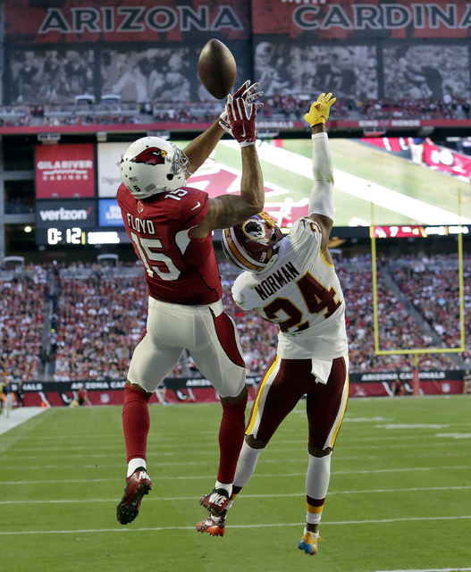 Washington Redskins cornerback Josh Norman (24) breaks up a pass intended for Arizona Cardinals wide receiver Michael Floyd (15) during the first half of an NFL football game, Sunday, Dec. 4, 2016 ...