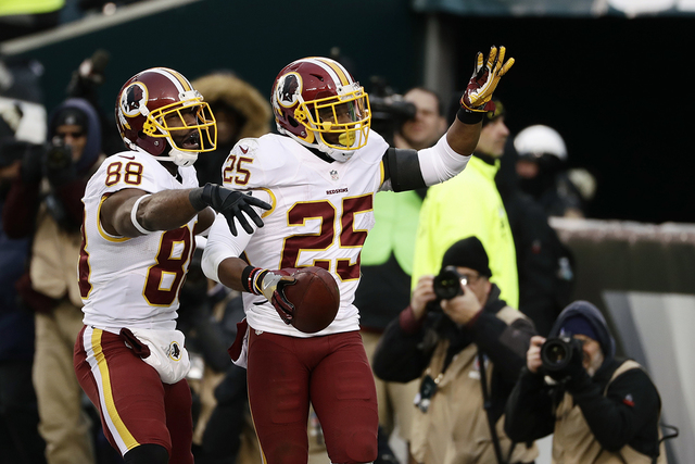 Washington Redskins' Chris Thompson (25) and Pierre Garcon (88) celebrate after a touchdown by Thompson during the second half of an NFL football game against the Philadelphia Eagles, Sunday, Dec. ...