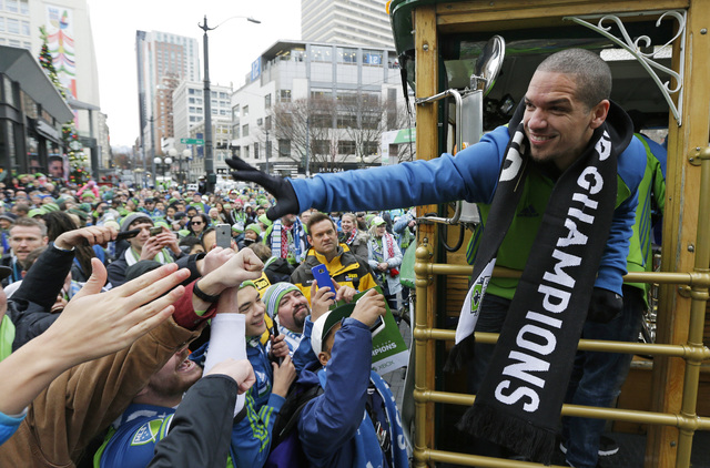 Seattle Sounders midfielder and captain Osvaldo Alonso greets fans during a celebration Tuesday, Dec. 13, 2016, in Seattle. The Sounders beat Toronto FC on Dec. 10 to win the MLS soccer championsh ...