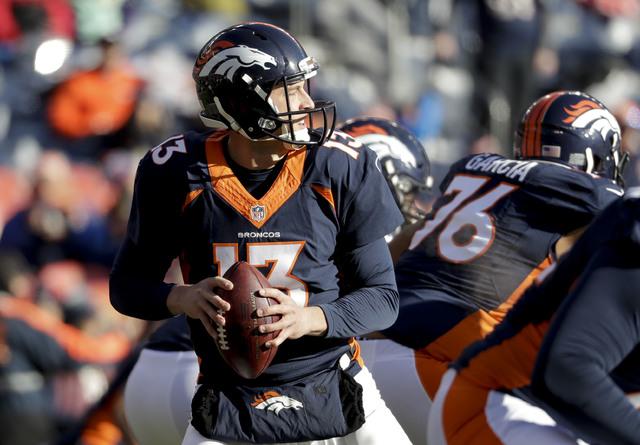 Denver Broncos quarterback Trevor Siemian warms up before an NFL football game against the New England Patriots Sunday, Dec. 18, 2016, in Denver. (Jack Dempsey/AP)