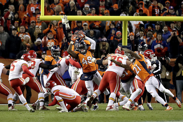 In this Sunday, Nov. 27, 2016 file photo, Kansas City Chiefs kicker Cairo Santos (5) kicks the game winning field goal as punter Dustin Colquitt (2) holds during overtime of an NFL football game a ...