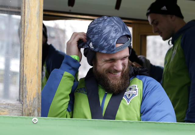 """Seattle Sounders goalie Stefan Frei smiles as fans chant """"MVP"""" before a rally and march celebrating the team's MLS Cup Championship Tuesday, Dec. 13, 2016, in Seattle. Seattle beat Toronto FC 5-4  ..."""
