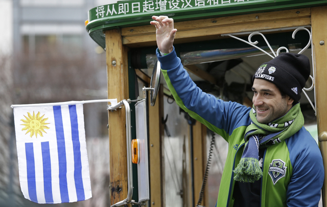 Seattle Sounders' Seattle Sounders midfielder Nicolas Lodeiro waves before a march and rally celebrating the team's MLS Cup Championship Tuesday, Dec. 13, 2016, in Seattle. Seattle beat Toronto FC ...