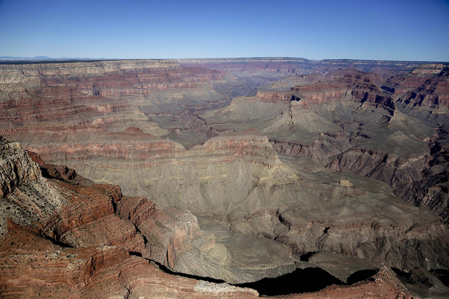 In this Oct. 5, 2013 file photo, Grand Canyon National Park is covered in morning sunlight as seen from a helicopter window, near Tusayan, Ariz.  (Julie Jacobson/AP)