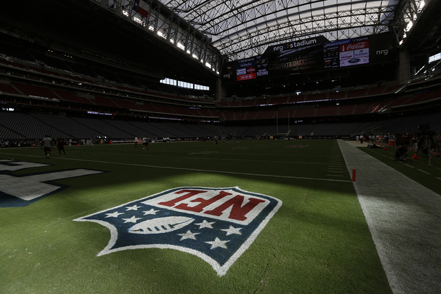 Sunlight hits the NFL logo on the field at NRG Stadium before an NFL football game Sunday between the Houston Texans and Washington Redskins, Sept. 7, 2014, in Houston. (David J. Phillip/AP)