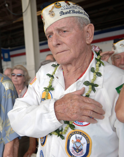 Woody Derby,  90,  (far right) with his hand over his heart, travels to Hawaii   every year  for the Pearl Harbor Commemoration in Pearl Harbor, Hawaii, Sunday Dec. 7, 2008. Derby was waist deep i ...