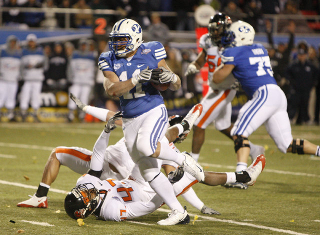 BYU's Manase Tonga (11) leaves a pair of Oregon State defenders in his wake during the second half of the Las Vegas Bowl NCAA college football game in Las Vegas, Tuesday Dec. 22, 2009 won by BYU 4 ...