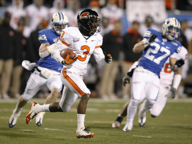 Oregon State's Patrick Henderson looks for room to run during the second half of the Las Vegas Bowl NCAA college football game in Las Vegas, Tuesday Dec. 22, 2009. BYU won 44-20. (AP Photo/Daniel  ...