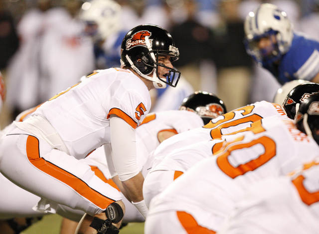 Oregon State quarterback Sean Canfield calls a play during the second half of the Las Vegas Bowl NCAA college football game against BYU in Las Vegas, Tuesday Dec. 22, 2009. BYU won 44-20. (AP Phot ...