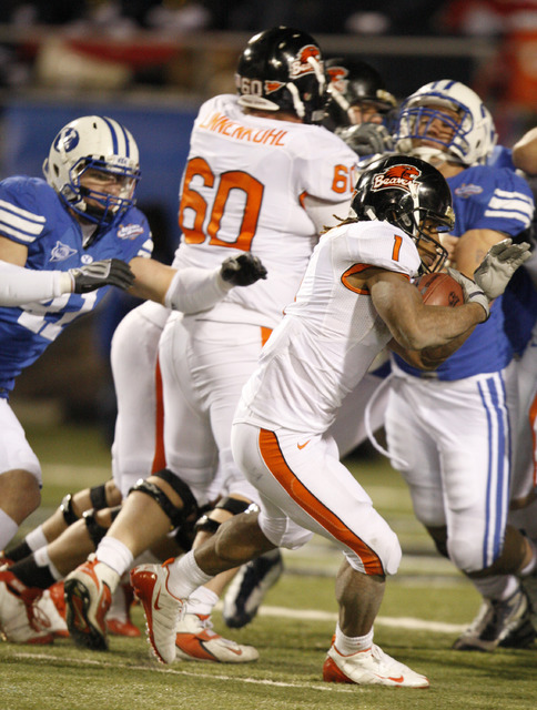 Oregon State's Jacquizz Rodgers runs on the way to a fourth quarter touchdown in the Las Vegas Bowl NCAA college football game in Las Vegas, Tuesday Dec. 22, 2009 won by BYU 44-20. (AP Photo/Danie ...