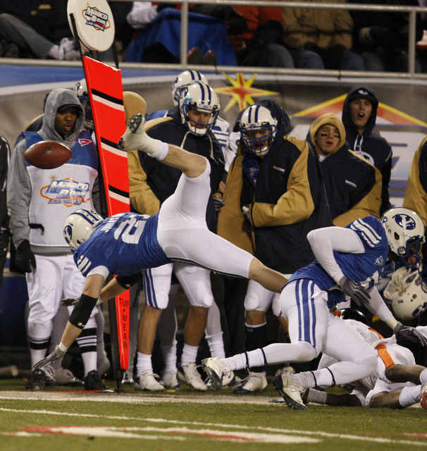 BYU's Scott Johnson (21) makes a diving attempt at an interception during the second half of the Las Vegas Bowl NCAA college football game in Las Vegas, Tuesday Dec. 22, 2009 won by BYU 44-20. (AP ...
