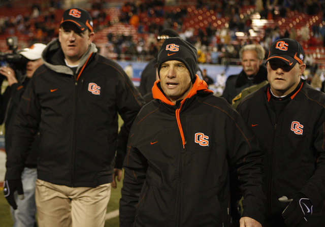 Oregon State head coach Mike Riley, center, leaves the field following the Las Vegas Bowl NCAA college football game in Las Vegas, Tuesday Dec. 22, 2009.Oregon lost to BYU 44-20. (AP Photo/Daniel  ...