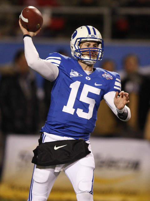BYU quarterback Max Hall gets off a pass during the first half of the Las Vegas Bowl NCAA college football game against Oregon State in Las Vegas, Tuesday Dec. 22, 2009. (AP Photo/Daniel Gluskoter)
