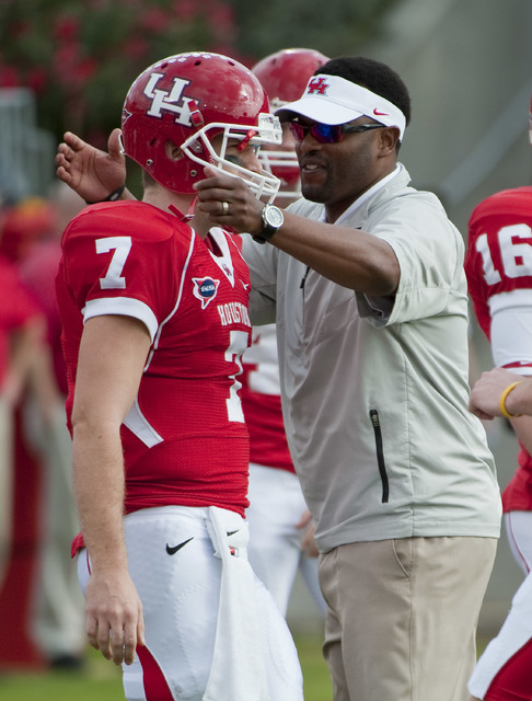 Houston head coach Kevin Sumlin, right, and Case Keenum (7) during a Conference USA championship NCAA college football game against Southern Mississippi, Saturday, Dec. 3, 2011, in Houston. Southe ...