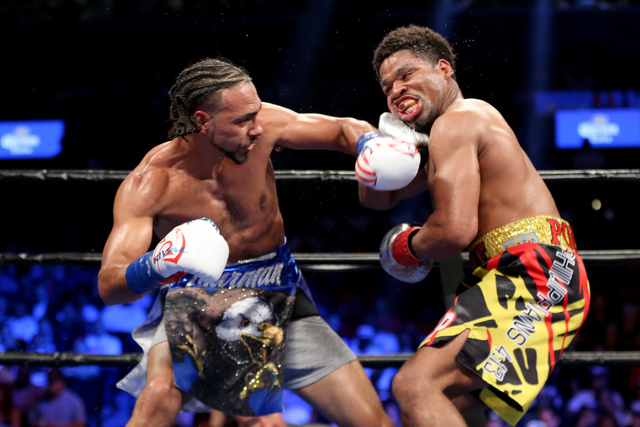 Keith Thurman, left, lands a left hand against Shawn Porter during their WBA Welterweight title fight at the Barclays Center in Brooklyn borough of New York on Saturday, June 25, 2016. Thurman won ...