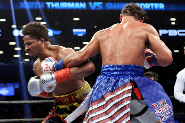 Keith Thurman, right, lands a left against Shawn Porter during their WBA Welterweight title fight at the Barclays Center in Brooklyn borough of New York on Saturday, June 25, 2016. Thurman won via ...