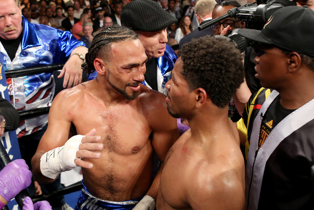 Keith Thurman, left, hugs Shawn Porter after their WBA Welterweight title fight at the Barclays Center in Brooklyn borough of New York on Saturday, June 25, 2016. Thurman won via unanimous decisio ...