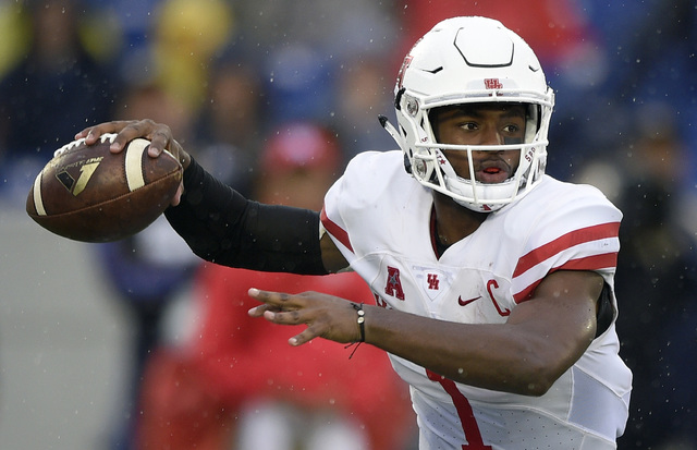 In this Oct. 8, 2016, file photo, Houston quarterback Greg Ward Jr. (1) looks to pass during the first half of an NCAA football game against Navy in Annapolis, Md. If Ward and the Cougars want to  ...