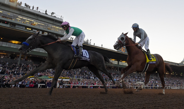 Arrogate with jockey Mike Smith, left, wins the Breeders' Cup Classic horse race over California Chrome, center, with Victor Espinoza at Santa Anita, Saturday, Nov. 5, 2016, in Arcadia, Calif. (AP ...