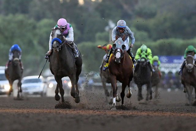 Arrogate with jockey Mike Smith, second from left, wins the Breeders' Cup Classic horse race over California Chrome, center, with Victor Espinoza at Santa Anita, Saturday, Nov. 5, 2016, in Arcadia ...