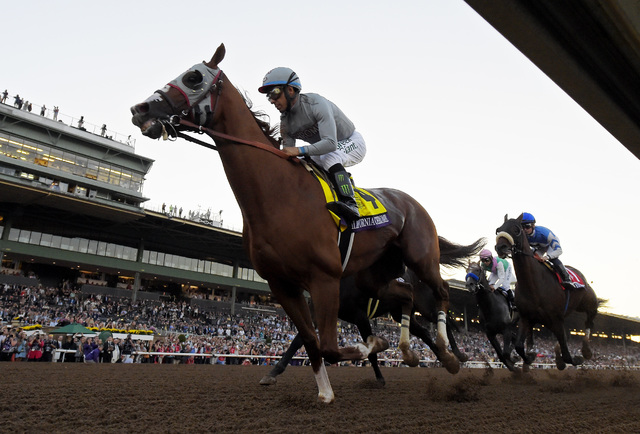 California Chrome with Victor Espinoza rides on the way to taking second in the Breeders' Cup Classic horse race at Santa Anita, Saturday, Nov. 5, 2016, in Arcadia, Calif. (Mark J. Terrill/AP)