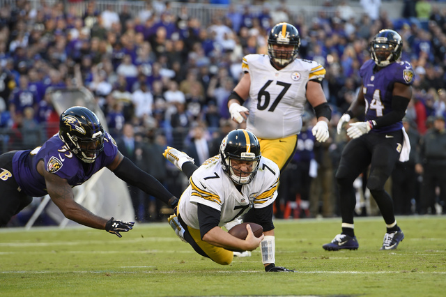 Pittsburgh Steelers quarterback Ben Roethlisberger (7) dives past Baltimore Ravens outside linebacker Terrell Suggs, left, for a touchdown in the second half of an NFL football game, Sunday, Nov.  ...