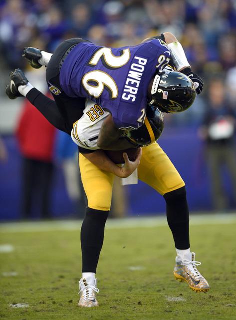 Baltimore Ravens cornerback Jerraud Powers sacks Pittsburgh Steelers quarterback Ben Roethlisberger in the second half of an NFL football game, Sunday, Nov. 6, 2016, in Baltimore. Baltimore won 21 ...
