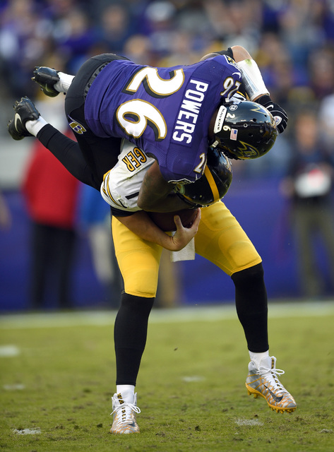 Baltimore Ravens cornerback Jerraud Powers sacks Pittsburgh Steelers quarterback Ben Roethlisberger in the second half of an NFL football game, Sunday, Nov. 6, 2016, in Baltimore. Baltimore won 21 ...