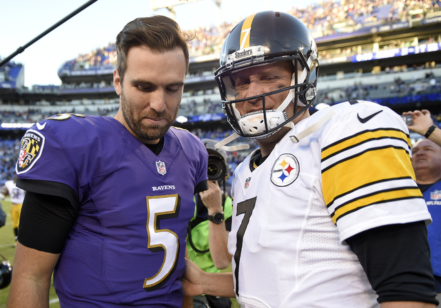 Baltimore Ravens quarterback Joe Flacco, left, and Pittsburgh Steelers quarterback Ben Roethlisberger walk off the field after talking following an NFL football game, Sunday, Nov. 6, 2016, in Balt ...