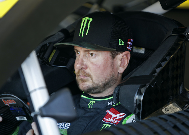 Kurt Busch sits in his race car before practice for the NASCAR Sprint Cup Series auto race at Phoenix International Raceway, Saturday, Nov. 12, 2016, in Avondale, Ariz. (Ralph Freso/AP)