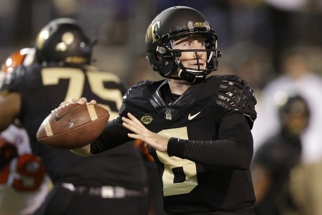 Wake Forest's Kyle Kearns (8) looks to pass against Clemson in the first half of an NCAA college football game in Winston-Salem, N.C., Saturday, Nov. 19, 2016. (Chuck Burton/AP)