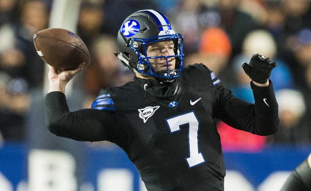 BYU quarterback Taysom Hill (7) throws the ball against Utah State in Provo, Utah, Saturday, Nov. 26, 2016. (Rick Egan/The Salt Lake Tribune via AP)
