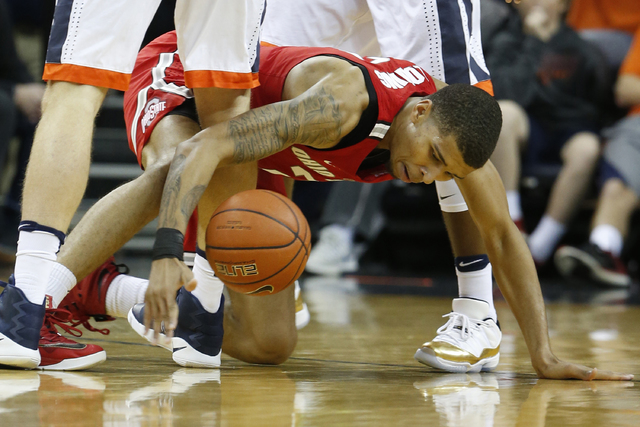 Ohio State forward Marc Loving (2) scrambles for the ball during the second half of an NCAA college basketball game in Charlottesville, Va., Wednesday, Nov. 30, 2016. Virginia won the game 63-61.  ...