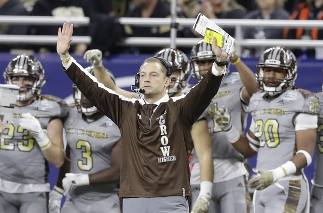 Western Michigan head coach P.J. Fleck signals during the first half of the Mid-American Conference championship NCAA college football game against Ohio, Friday, Dec. 2, 2016, in Detroit. (Carlos  ...