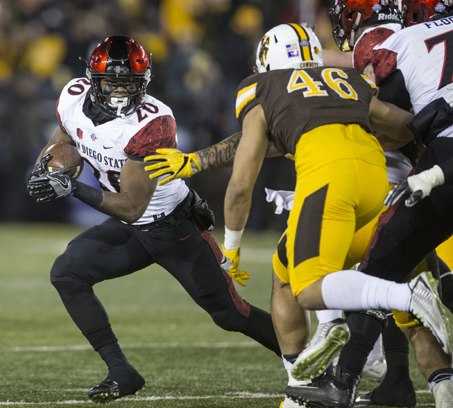 San Diego State's Rashaad Penny runs for yardage against Wyoming during the first half of an NCAA college football game, Saturday, Dec. 3, 2016, in Laramie, Wyo. (Michael Smith/AP)