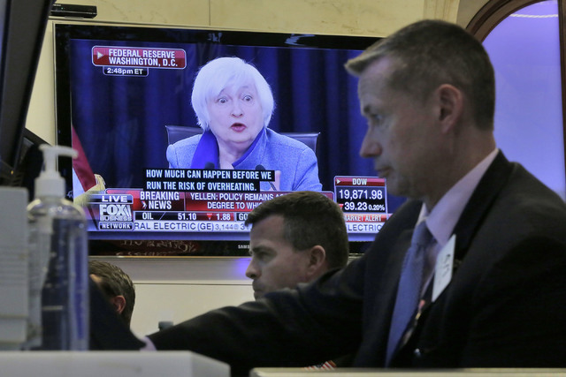 Federal Reserve Chair Janet Yellen's news conference in Washington appears on a screen on the floor of the New York Stock Exchange, Wednesday, Dec. 14, 2016. Stocks slipped Wednesday after the Fed ...
