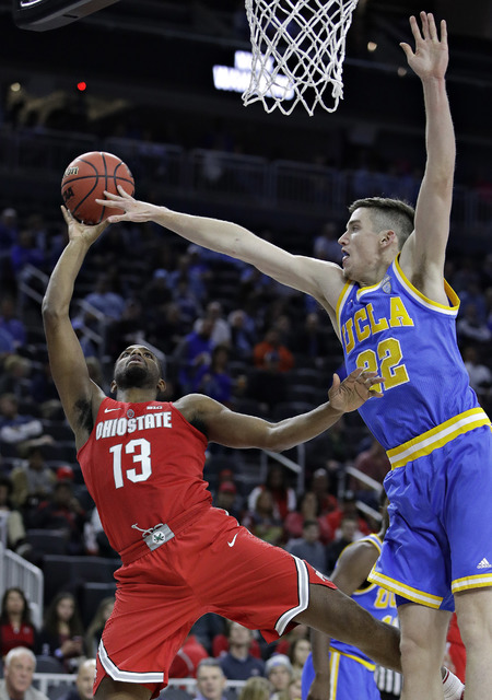 Ohio State's JaQuan Lyle (13) shoots around UCLA's TJ Leaf during the second half of an NCAA college basketball game Saturday, Dec. 17, 2016, in Las Vegas. UCLA won 86-73. (AP Photo/John Locher)
