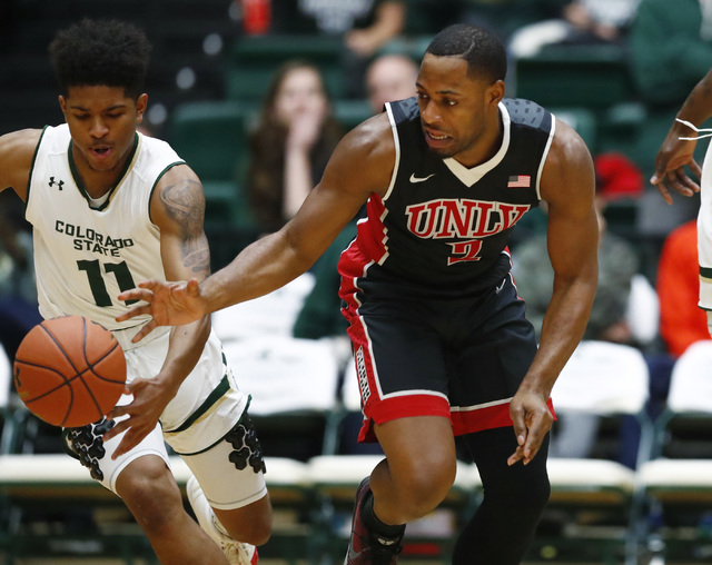 Colorado State guard Prentiss Nixon, left, steals the ball from UNLV guard Uche Ofoegbu during the first half of an NCAA college basketball game Wednesday, Dec. 28, 2016, in Fort Collins, Colo(AP  ...