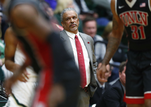 UNLV head coach Marvin Menzies, back, watches during the first half of the team's NCAA college basketball game against Colorado State on Wednesday, Dec. 28, 2016, in Fort Collins, Colo. (AP Photo/ ...