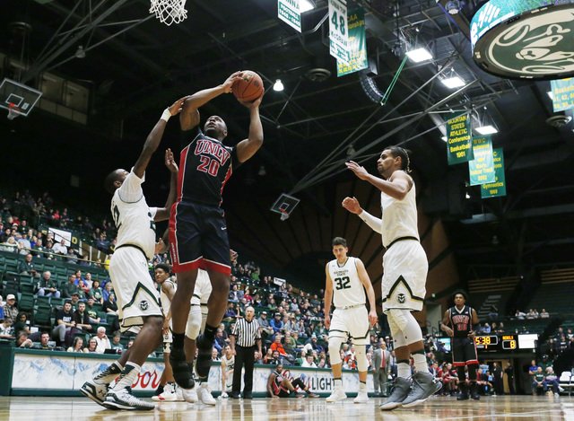 UNLV forward Christian Jones, center, goes up for a basket as Colorado State guards J.D. Paige, left, and Gian Clavell defend during the first half of an NCAA college basketball game Wednesday, De ...