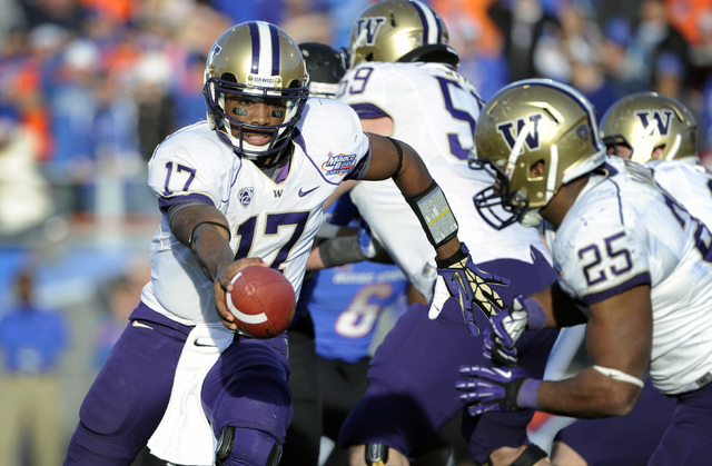 Washington quarterback Keith Price (17) hands off the ball to Bishop Sankey (25) during second half of the MAACO Bowl NCAA college football game against Boise State, Saturday, Dec. 22, 2012, in La ...