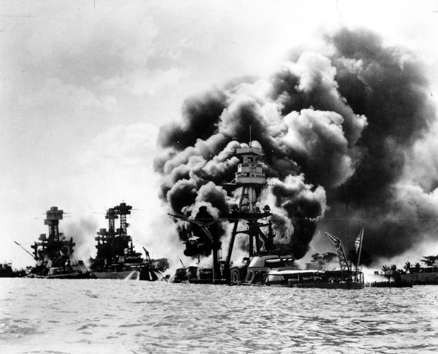 Three U.S. battleships are hit from the air during the Japanese attack on Pearl Harbor on Dec. 7, 1941.  Japan's bombing of U.S. military bases at Pearl Harbor brings the U.S. into World War II. F ...