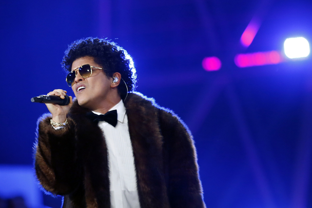 US singer Bruno Mars performs during the Victoria's Secret Fashion Show inside the Grand Palais, in Paris, Wednesday, Nov. 30, 2016. The pulse-quickening, celebrity-filled catwalk event of the yea ...