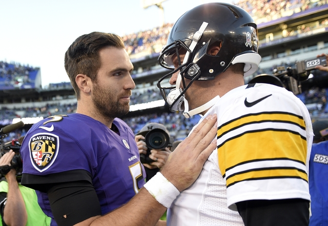Baltimore Ravens quarterback Joe Flacco, left, and Pittsburgh Steelers quarterback Ben Roethlisberger chat after an NFL football game, Sunday, Nov. 6, 2016, in Baltimore. (AP Photo/Nick Wass)