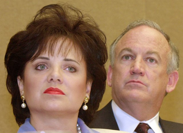 Patsy Ramsey and her husband, John, parents of JonBenet Ramsey, look on during a news conference in Atlanta in 2000.  (Ric Feld/The Associated Press)