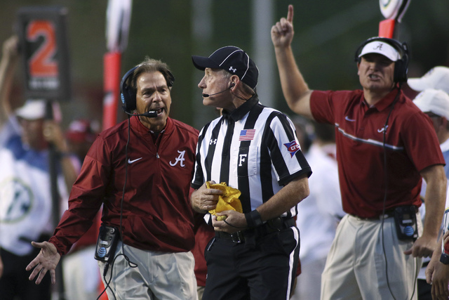 Alabama coach Nick Saban questions field judge Bobby Ables during the second quarter of the team's NCAA college football game against Arkansas on Saturday, Oct. 8, 2016, in Fayetteville, Ark. Alab ...